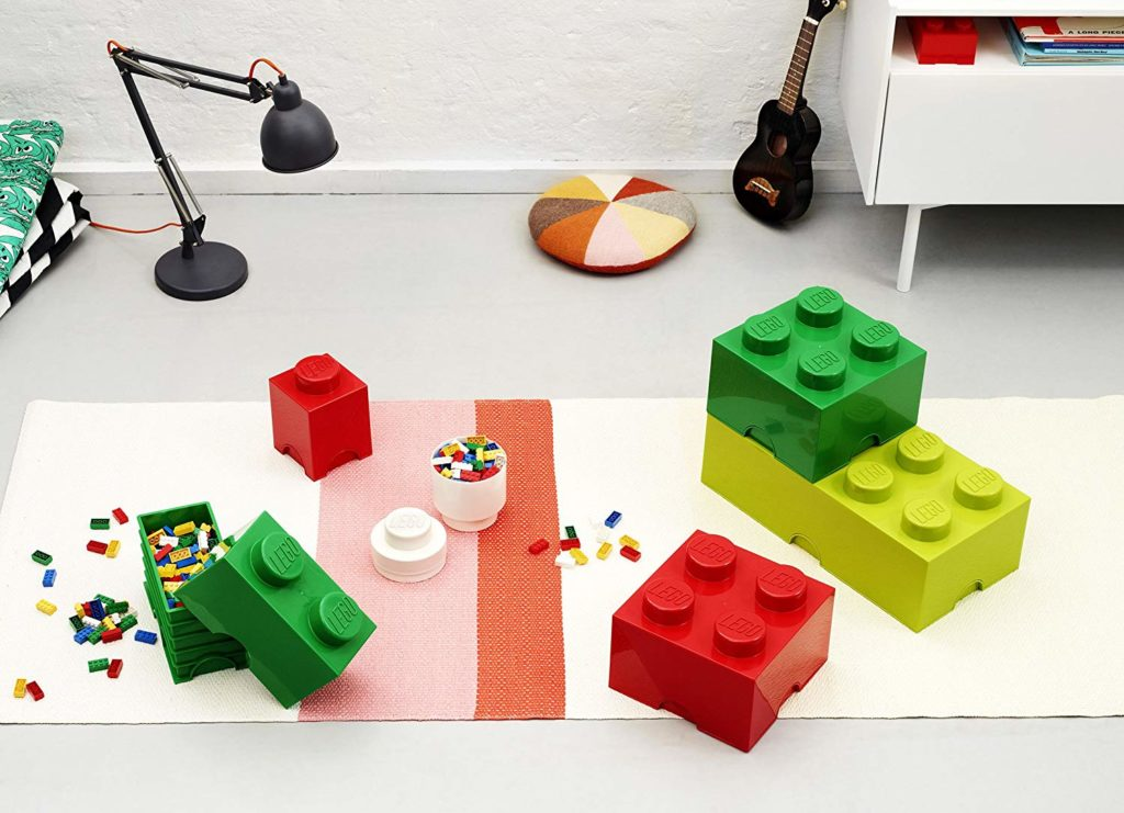 Lego Storage Blocks: These cute LEGO Brick storage boxes are a clever way to store your LEGO brick collection, or even just an easy way to travel with LEGOs, especially useful for holiday visits and family vacations. Multiple-sized plastic storage brick bins are a fun way to decorate and to keep bricks off of your floor, too!