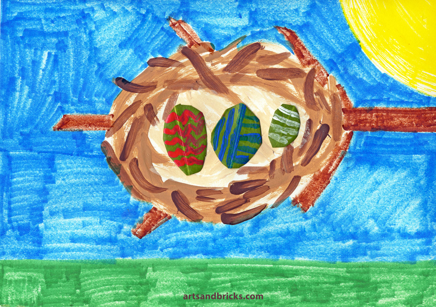 Kid-painted nest in tree branch, Easter eggs made from cut and painted leaves. Kids Artwork.