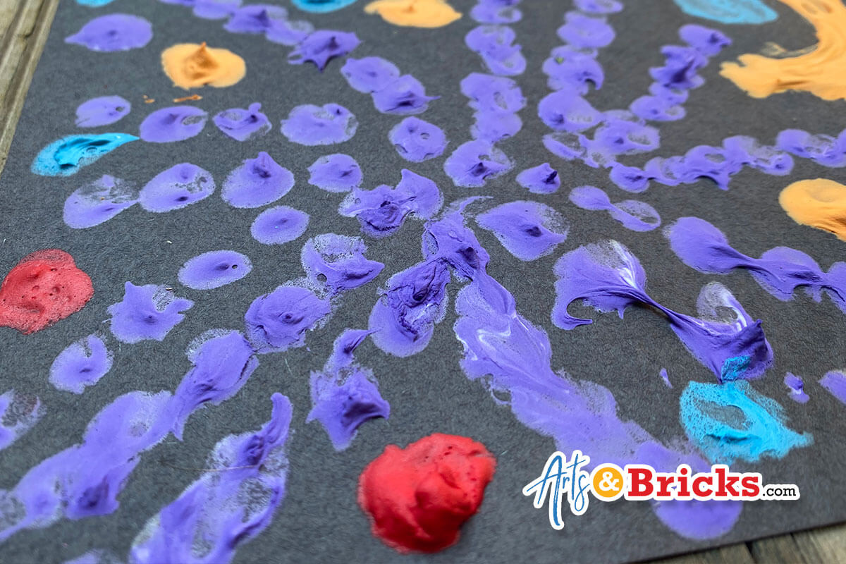Blog post about how to make puffy paint for kids using shaving cream, glue and paint