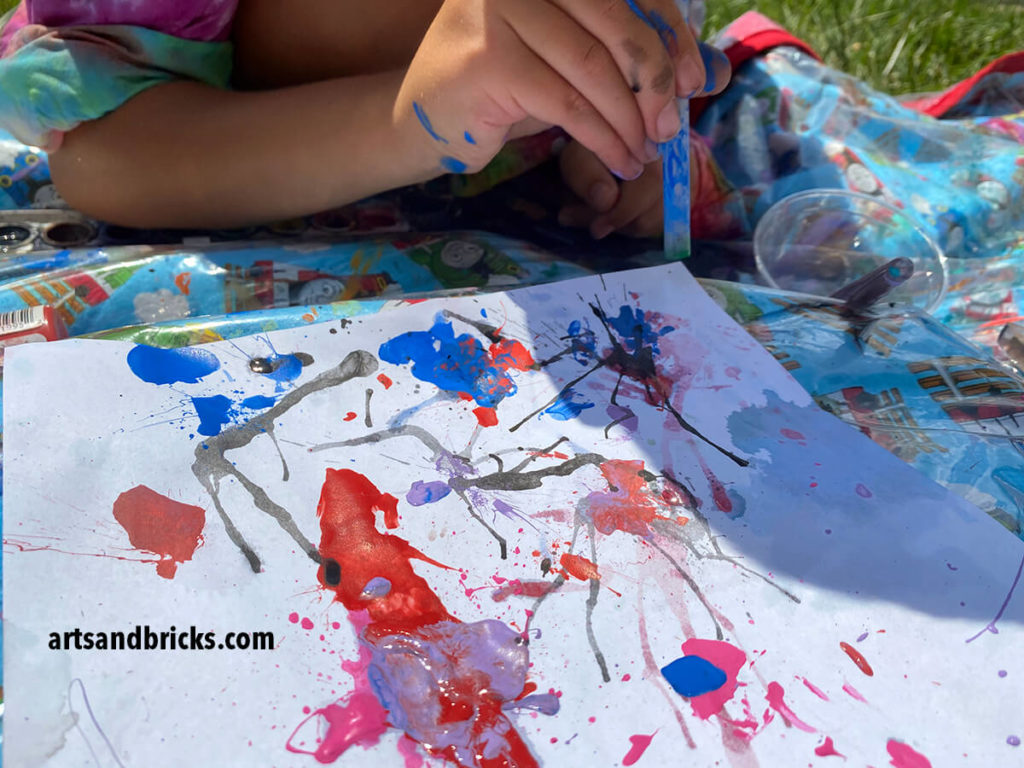 Create abstract art with watercolor paint and a straw. Watching the paint and water blow and drip is mesmerizing!