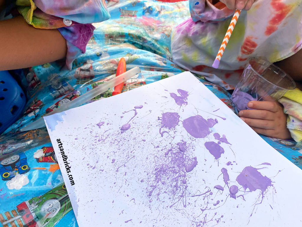 Painting with acrylic paint and straws. Use the straws to flick paint, splatter paint and blow paint around on the page.