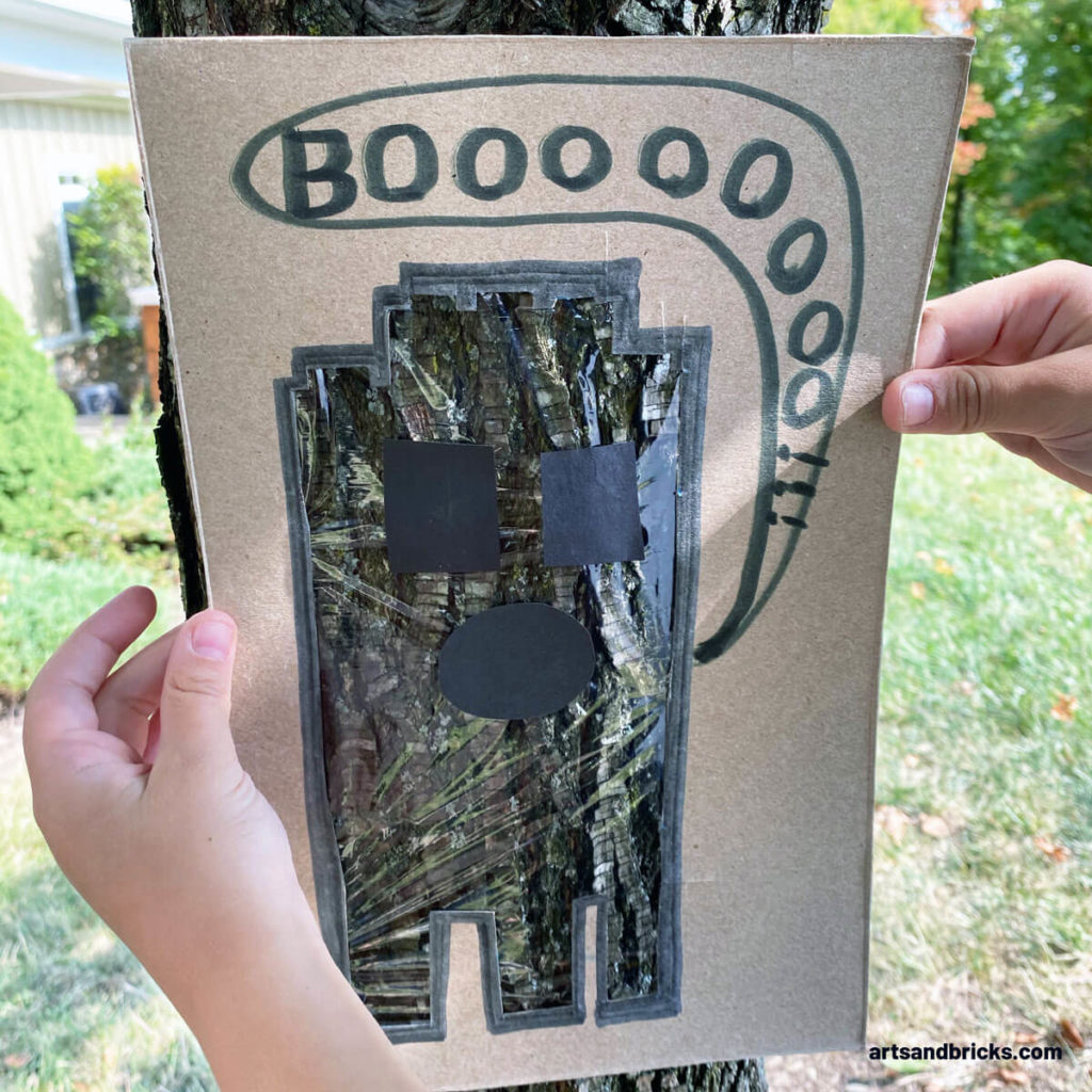 Explore your surroundings -- like a tree trunk -- with this Ghost Peek-A-Boo Cardboard Craft! Use cardboard (we used a cereal box panel) to create a ghost. Ours is a LEGO brick ghost!!! Add plastic wrap over the body and tape on a spooky face. Don't forget to add a BOO! Next is the fun part, start framing textures and colors - both indoors and outdoors. Don't forget to take pictures! Have fun! #lego #craft #google #cardboard #forkids #easy #recycled #naturecrafts