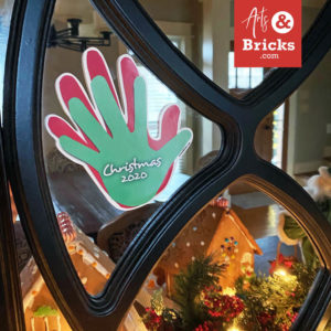 Holiday family handprint printed on window vinyl displayed in your home as holiday decor