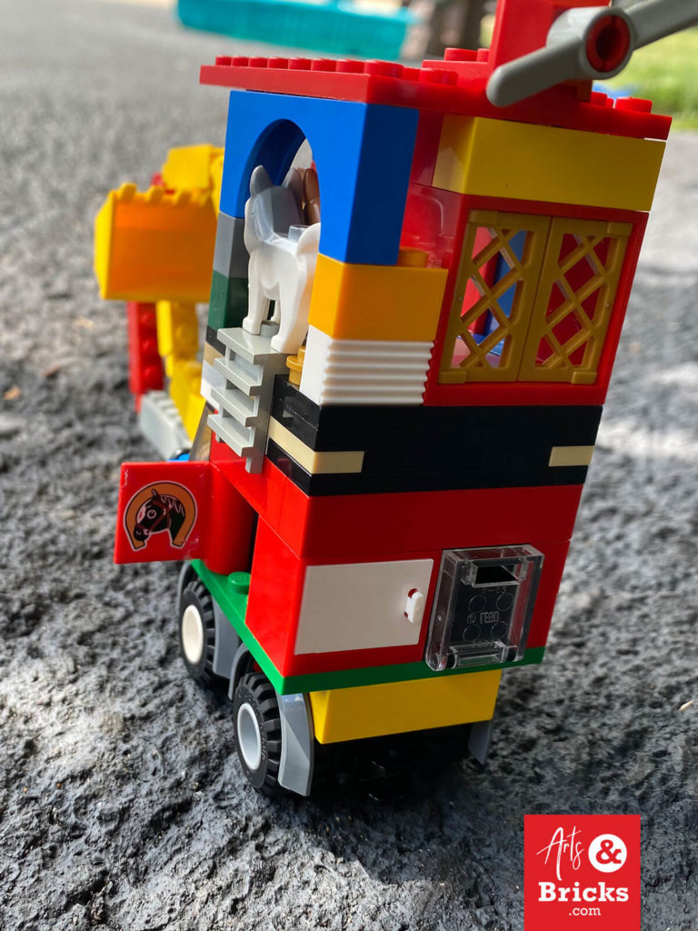 Introducing the Dig-O-Matic. This feat of eight-year-old engineering is most notable for its rollable hinged digger bucket! Its playful functionality is created by connecting eight hinged Lego bricks to the bucket. See more images and our favorite additions on our blog.