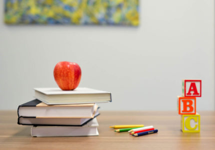 A book on desk with apple and ABC blocks - Photo by Element5 Digital on Unsplash