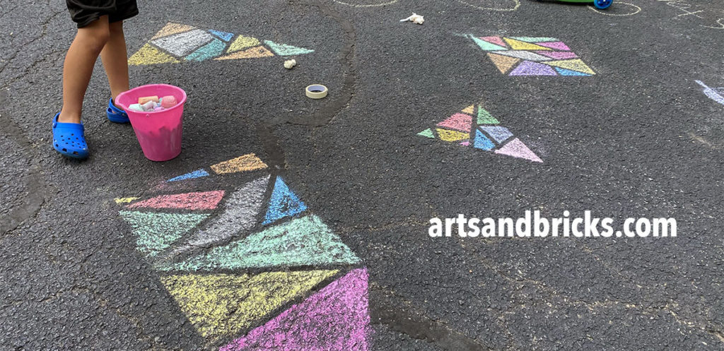 One of my favorite things about outdoor chalk art projects is they allow kids to play with SCALE! Designs are not confined to small paper shapes but instead, designs can span entire driveways. The ability to fully move around a design and to create art as large or small as you choose is VERY FREEING!