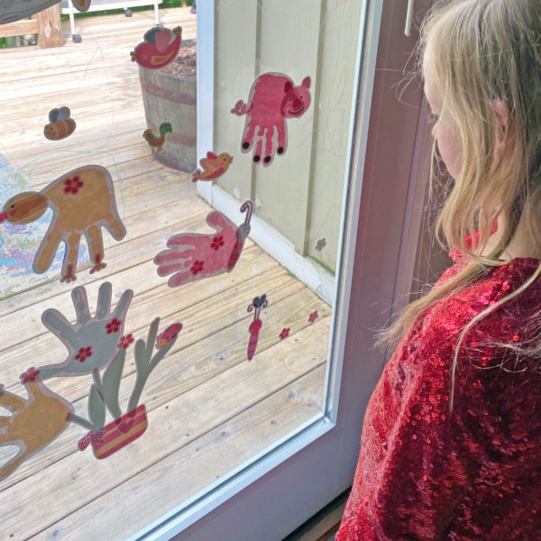 Handprint art turned into wall decals and window cling for play