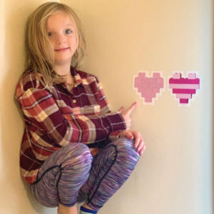 Heart shapes built with LEGO bricks and printed as wall decals