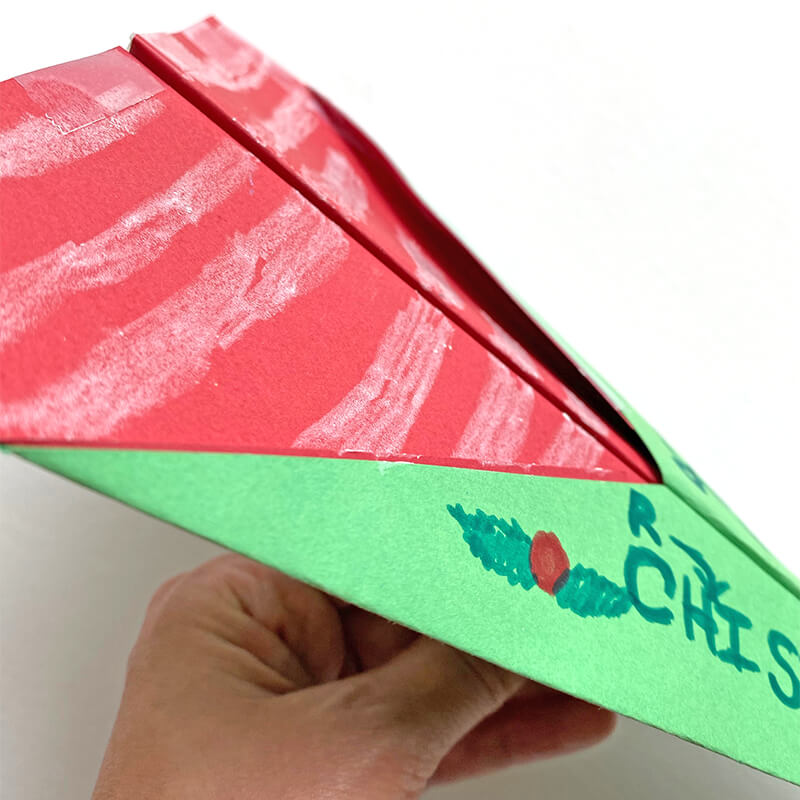 Find inspiration for a Christmas-themed paper airplane! Candy-cane striping, holly berries and lots of Christmas Cheer! We used card stock, tape, staples, markers and crayons!