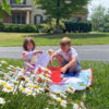 Kids experimenting with paint and art outside in the summer