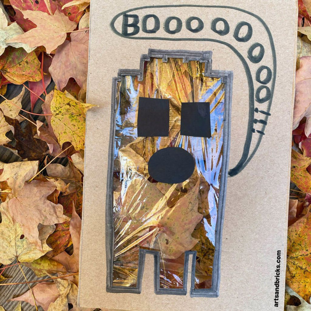 Explore your surroundings -- like fallen autumn leaves -- with this Ghost Peek-A-Boo Cardboard Craft! Use cardboard (we used a cereal box panel) to create a ghost. Ours is a LEGO brick ghost!!! Add plastic wrap over the body and tape on a spooky face. Don't forget to add a BOO! Next is the fun part, start framing textures and colors - both indoors and outdoors. Don't forget to take pictures! Have fun! #lego #craft #google #cardboard #forkids #easy #recycled #naturecrafts