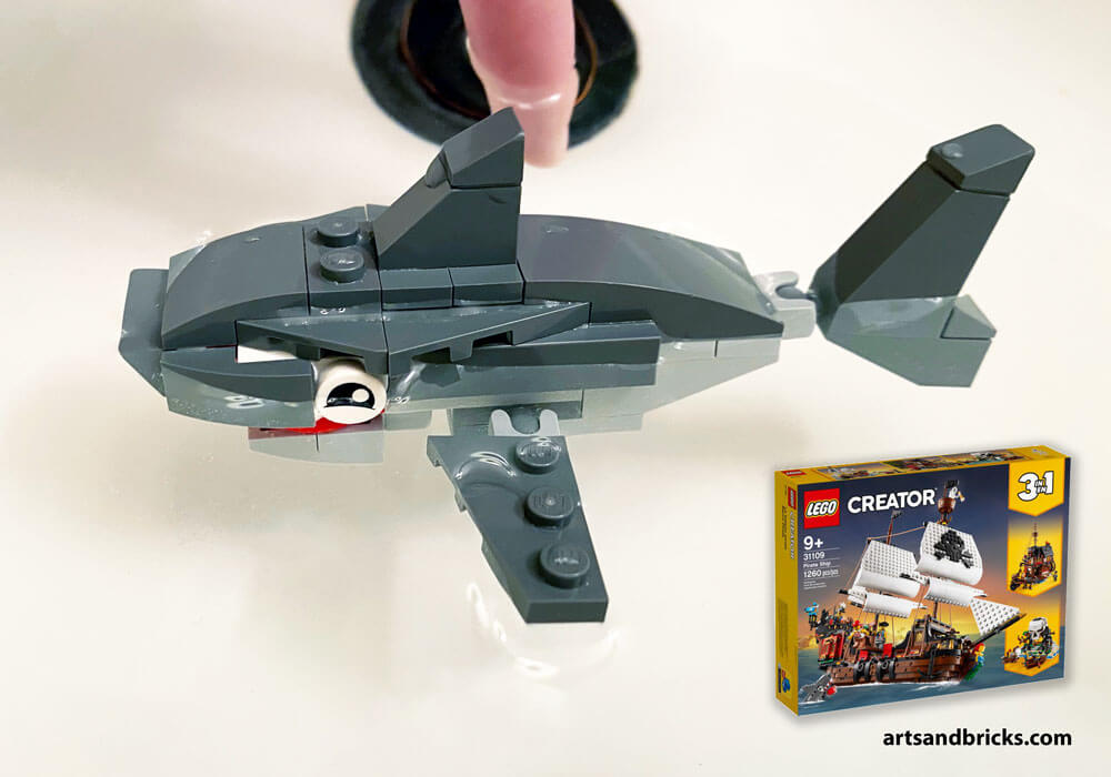 One of our favorite sets to date, LEGO 31109 Pirate Ship, includes the pieces and instructions for this Pirate-chomping shark. Check out our reviews of each of the builds included in this LEGO Creator 3-in-1 Set. Pictures and answers to whether or not this shark floats included!