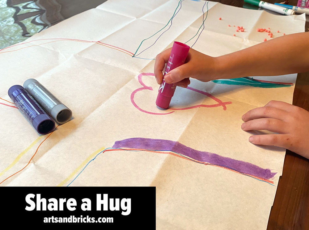 Learn how to make, mail, and share a paper hug from your child! This fun and simple kids craft activity spreads joy to everyone! Get inspired and check out instructions on our blog post. #kidsart #mailahug #gifts #diycraft