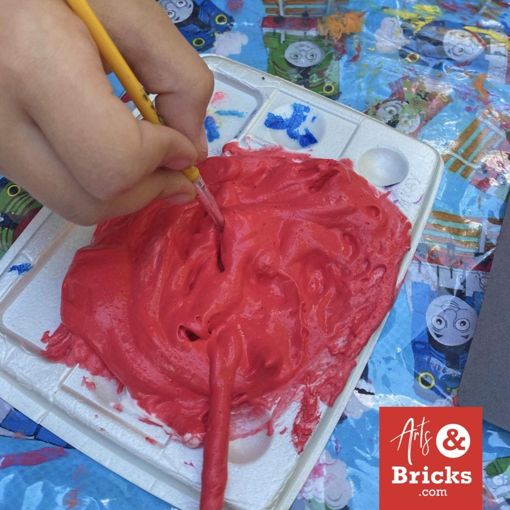 This is red puffy paint created with Barbasol Original Shaving Cream, Elmers Glue and acrylic red paint. #puffypaint #artproject #4thofjuly #fireworks
