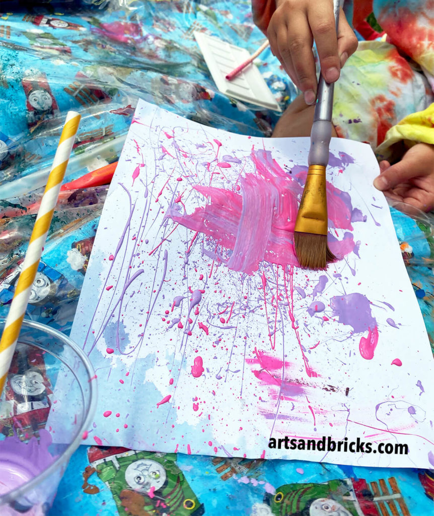 Experimental painting with straws and brushes sparks children's imaginations and lets them create freely - exploring the medium without fears of creating anything realistic.