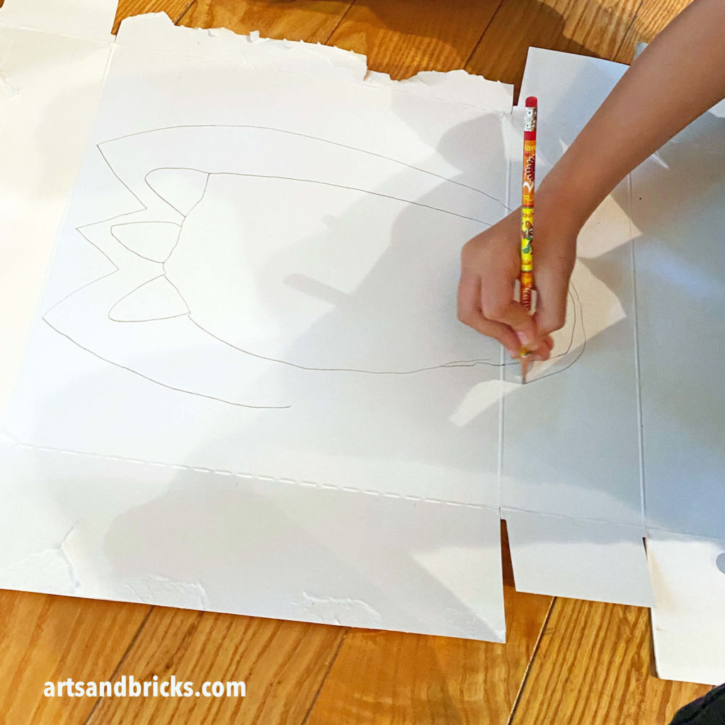 Rooaar! Stomp! This easy craft is sure to become a family favorite! Create your very own dinosaur feet with just three craft supplies: markers, cardboard, scissors and optional pipe cleaners.